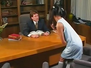 Naughty asian babe with pigtailes gives blowjob in office