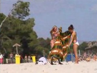 Two topless lesbo girls on the beach
