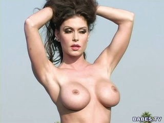 Perverted little Jessica Jaymes poses bare after stripping outdoors
