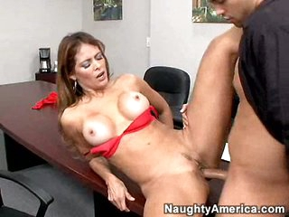 Tired of answering phones, hot secretary Monique Fuentes answers to a large penis