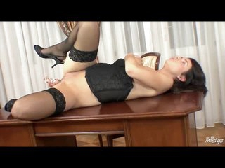 Hot gal in a black corset toys her vagina