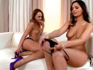 Blue Angel and Eve Angel are two sexy ladies with long legs and wonderful natural tits. They bare it all in front of each other to enjoy lesbian sex on the white couch.