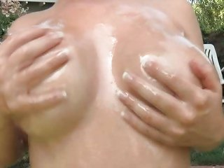 Katy Karson gets oiled up for an outdoor fucking