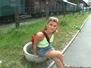 Blond shows tits off behind a railroad car