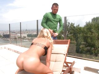 blonde with curly hair gettind rammed on a rooftop