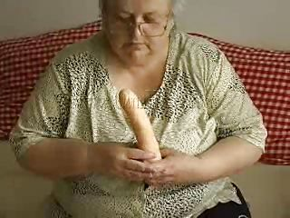 gray haired granny and her huge dildo