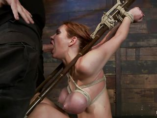 tied bitch getting her pretty mouth stuffed with cock