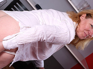 Horny blond mama engulfing dick