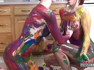 Tattooed redheads Indigo and Lavender receive erotic with paint