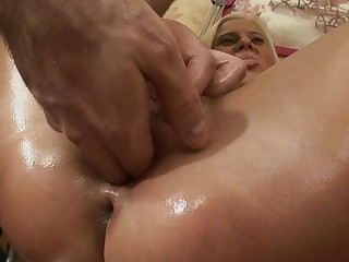 A blonde that has oil over her sexy ass is getting anal loving