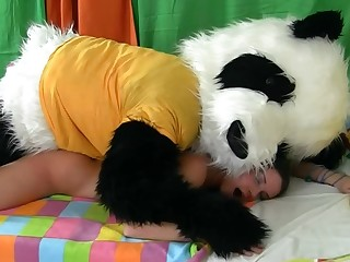 Hot woman is getting fucked by a guy that is in a panda costume