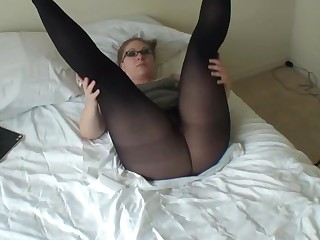 Nice looking redhead shows her big booty in nylons