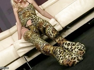 Fleshly blonde pornstar with foot fetish positions in lepard print lingerie