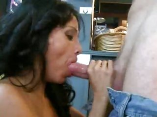 Luscious milf shoves a massive dick down her throat
