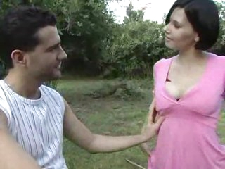 Girl in a pink dress sucks dick outdoors