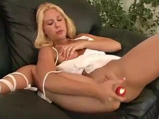 Pleased blonde squirts during her toy play