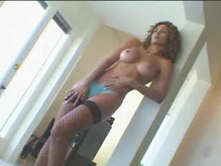 Latin milf with curly hair and large merry tits